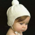 Как связать шапочку спицами для новорожденного